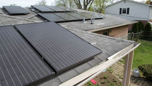 An Indiana couple had 32 solar panels installed on the roof of their home. House Bill 1320 will cut the amount of money that power companies must pay when they buy excess energy from home systems.