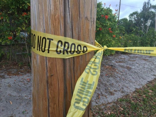 Crime scene tape stretches along the area where a man's body was found early Tuesday, Feb. 21, 2017, just west of the interchange for Florida's Turnpike in Fort Pierce.