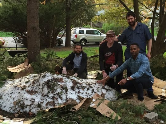 Arie Kandel and his team pose with the pile of snow