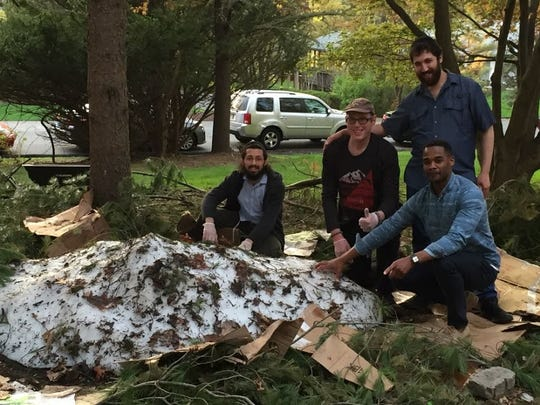 Arie Kandel and his team pose with the pile of snow that once was his snowman.