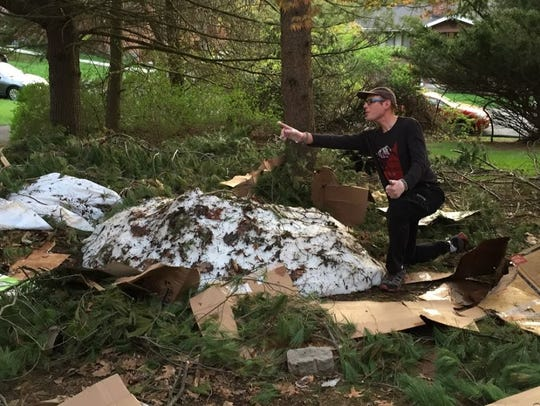 Arie Kandel poses with the pile of snow that once was