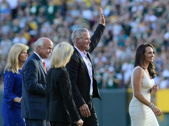Brett Favre waves to the fans as he makes his way to the tunnel after the ceremony honoring him at Lambeau Field.
