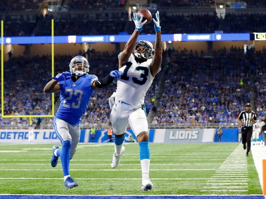 FILE - In this Oct. 8, 2017, file photo, Carolina Panthers wide receiver Kelvin Benjamin (13) makes a touchdown catch as Detroit Lions cornerback Darius Slay (23) defends during an NFL football game in Detroit. The Buffalo Bills have upgraded their patchwork group of receivers by agreeing to acquire Benjamin in a trade with the Panthers. Carolina acquired Buffalo's third- and seventh-round picks in next year's draft in making the deal reached just before the NFL's trade deadline on Tuesday, Oct. 31, 2017.  (AP Photo/Paul Sancya, File)