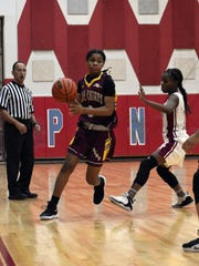 Natchitoches Central's Junti Franklin (3, left) drives the ball down the lane against Pineville last season.