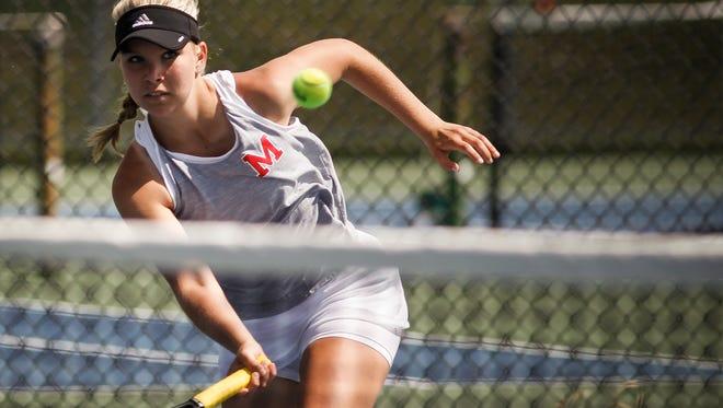 No. 1 singles Mason senior Liv Hanover works the net against Rohitha Polasani of Jackson Thursday, May 18, 2017, during the Div. 2 regional tennis finals at Okemos High School.  [MATTHEW DAE SMITH/Lansing State Journal]