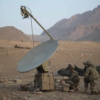 U.S. Soldiers, with Headquarters and Headquarters Company, 4th Brigade Special Troops Battalion, 4th Brigade Combat Team, 10th Mountain Division, set up a satellite in the Chak district, Wardak province, Afghanistan, July 26, 2011. (U.S. Army photo by Staff Sgt. Samantha Bennett/Released)