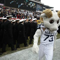 Navy head coach Ken Niumatalolo gestures to fans as he walks off the field after winning 21-17 against Army, their 14th straight victory against them. (AP Photo/Matt Rourke)