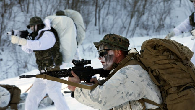 U.S. Marines and South Korean Marine Corps soldiers in white winter camouflage engage in evacuation training during a cold weather drill in Pyeongchang, South Korea, Dec. 19, 2017 (issued Dec. 20, 2017).