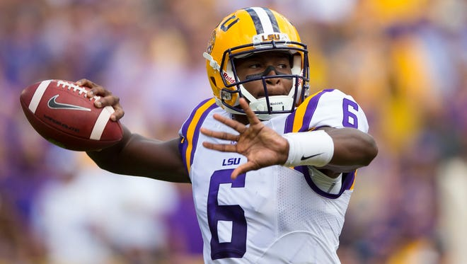 LSU Tigers quarterback Brandon Harris (6) throws a pass during the first quarter against the Wisconsin Badgers at Lambeau Field.