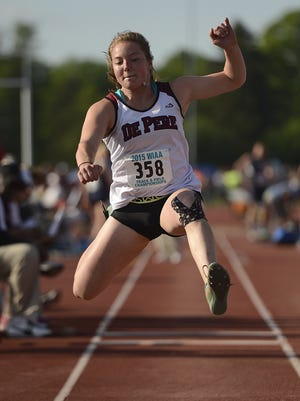 De Pere's Sydney Otto flies through the air while competing in the the Division 1 triple jump at last year's WIAA state track and field meet at Veterans Memorial Stadium Complex in La Crosse. Otto, who set three school records last year, tore the ACL in her right knee before this season.