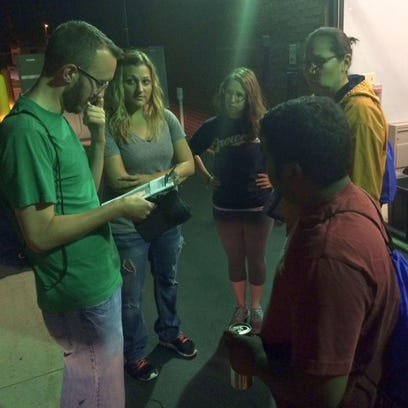 From left, team leader Matt Maloney and volunteers