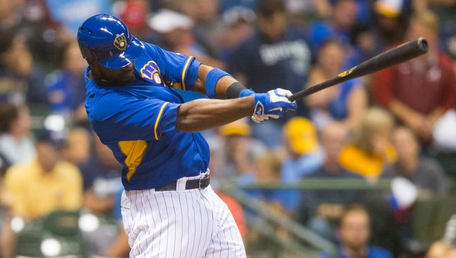 Brewers first baseman Chris Carter hits a home run during the second inning Friday night against the Reds.