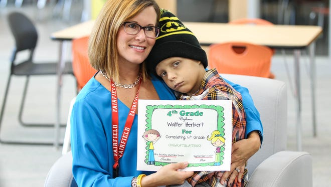 """Walter """"SuperBubz"""" Herbert completes multiple grades of school in one day at Fairfield Central Elementary school on Thursday, Sept. 7, 2017."""