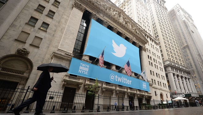 In this November 7, 2013 file photo, a banner with the logo of Twitter is set on the front of the New York Stock Exchange (NYSE) in New York.