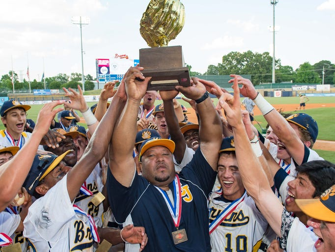 St. Joseph players celebrate with the trophy after