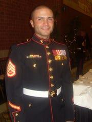 Javier Ortiz-Rivera in his Marine dress. He was killed on active duty in Afghanistan in November 2010. He was 26.