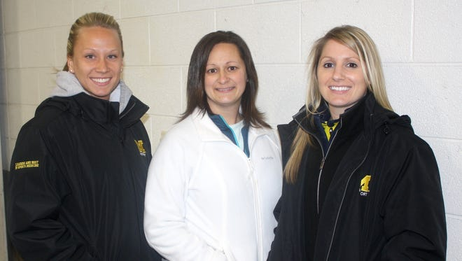 Pictured from left are Livonia high school athletic trainers Shannon Siira (Franklin), Jennifer Kramer (Stevenson) and Carly Gunterman (Churchill).
