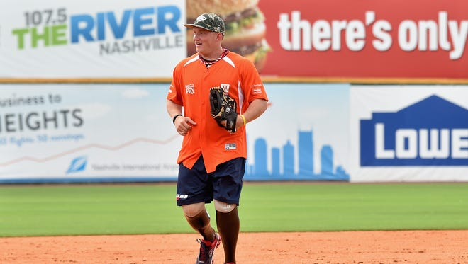 Retired Lance Corporal Josh Wege, who is on the Wounded Warriors' roster for Saturday's game against the Elmira Pioneers, participates in the City of Hope Celebrity Softball Game on June 7, 2014 in Nashville, Tennessee.