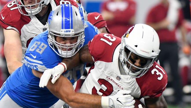 Lions defensive end Anthony Zettel tackles Cardinals running back David Johnson in the opener Sunday, Sept. 10, 2017 in Detroit.