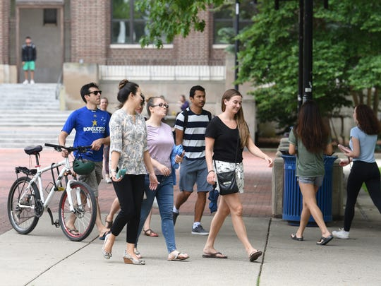 Students walk through the Diag on the University of Michigan campus.