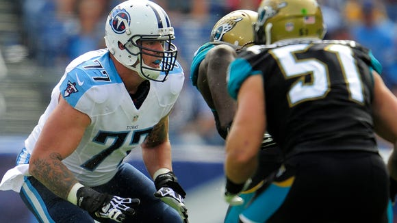 Titans tackle Taylor Lewan looks to make a block during