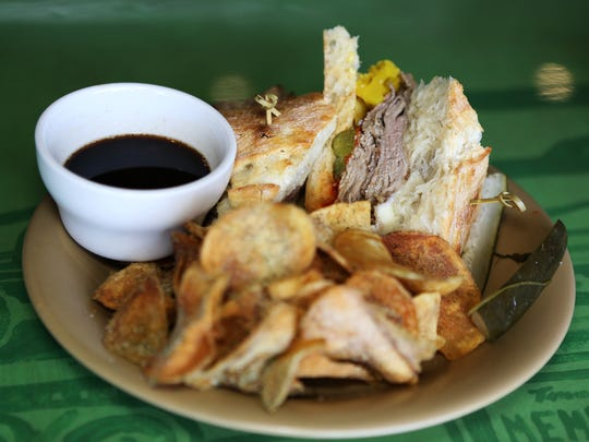 January 22, 2018 - The Sonny Corleone sandwich at Sunrise Memphis includes Italian style roast beef, provolone, pickled peppers (hot or sweet), giardenera, au jus and comes with ranch chips. The restaurant is located at 670 Jefferson Ave.