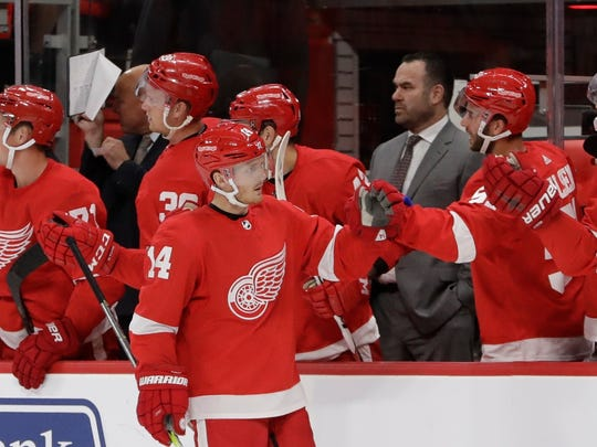 Red Wings center Gustav Nyquist (14) greets teammates after scoring during the first period of the exhibition game on Friday, Sept. 29, 2017, at Little Caesars Arena.