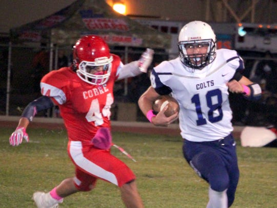 Silver quarterback Joe Hanson escapes the grasp of Cobre's Randy Maynes during action Friday night in Bayard. Hanson tallied 16 attempts for 18 yards on the ground, while Maynes had 10 tackles on the night including one for a loss.