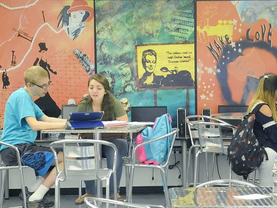 Students work in Fernley High School's career center on the first day of school.