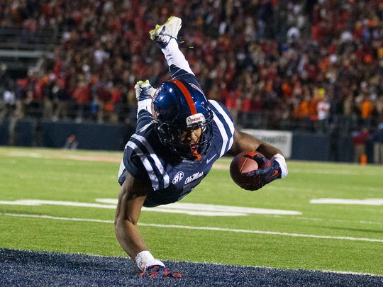 Brynn Anderson/APOle Miss running back I'Tavius Mathers dives in for a touchdown against Auburn during the first half Saturday night. Mississippi running back I'Tavius Mathers dives in for a touchdown against Auburn during the first half of an NCAA college football game Saturday, Nov. 1, 2014, in Oxford, Miss. (AP Photo/Brynn Anderson)