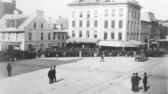 Yorkers gathered for a parade in 1892.  Punch is near where he was in the photo above, but now suspended or on a pedestal at the edge of the first floor canopy.