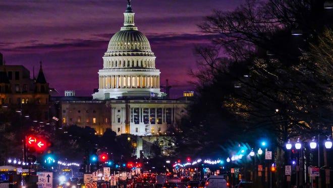 Early morning traffic rolls toward the U.S. Capitol on Dec. 14, 2016.