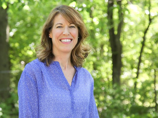 Cindy Axne is a fifth-generation Iowan, small business owner, parent, and community activist. She is running for Congress in Iowa's Third District.