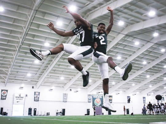Michigan State's Khari Willis, left, and Justin Layne have fun on media day Aug. 7, 2017 in East Lansing.
