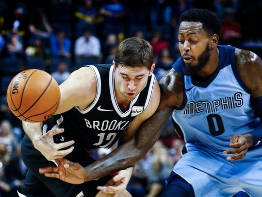 Memphis Grizzlies forward JaMychal Green (right) battles Brooklyn Nets defender Joe Harris (left) for a loose ball during first quarter action at the FedExForum in Memphis, Tenn., Sunday, November 26, 2017.