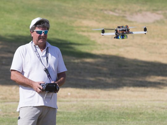 The debate over the use of drones is growing in the Valley and across the nation as more hobbyists use them for fun and more companies use them to carry out business. Mike Parker (above), owner of Arizona Technology Group Inc., flies his drone at Thude Park in Chandler.