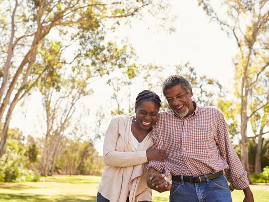 Outdoor Shot Of Mature Couple Walking In Park Together