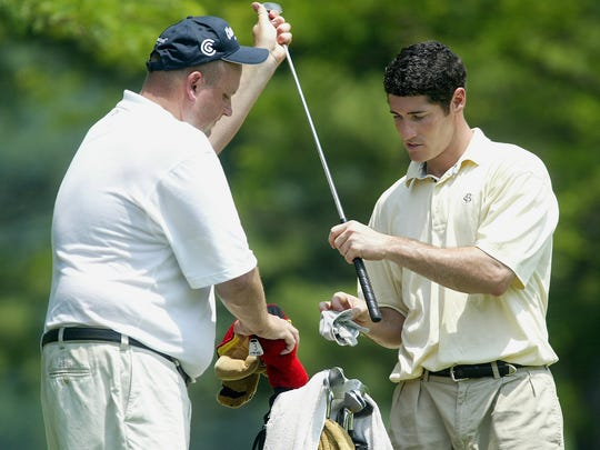 John Doherty, Red Bank, caddie's for Mike Deo during the 2004 N.J. Amateur at Spring Brook Country Club.