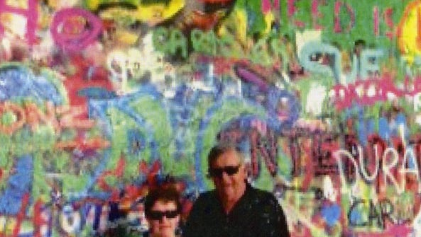 Neale and Meg Bellamy at the Lennon Wall, Prague.