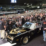 "Burt Reynolds gives an introduction before the auction of the 1977 Pontiac Firebird Trans Am ""Smokey and the Bandit"" Promo Car at Barrett-Jackson in Scottsdale, AZ on January 30, 2016."
