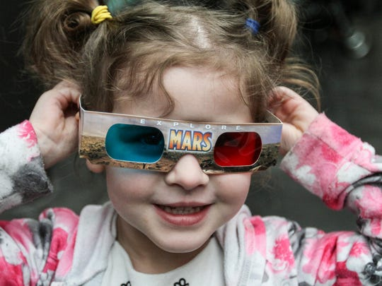 Piper Brown, 4, looks at space scenes through 3D glasses during Astronomy Day at the Morris Museum in Morristown.