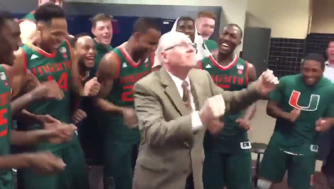 Miami coach Jim Larranaga dances after a huge win over Virginia.