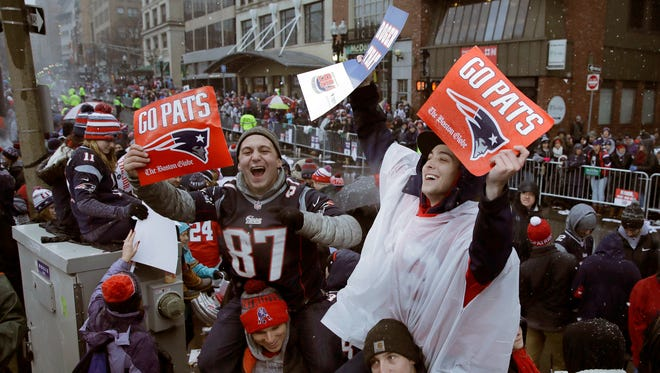 New England Patriots fans wait for the start of a parade Tuesday, Feb. 7, 2017, in Boston to celebrate their team's 34-28 win over the Atlanta Falcons in Sunday's NFL Super Bowl 51 football game in Houston. (AP Photo/Charles Krupa)