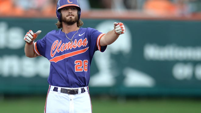 Clemson's Reed Rohlman (26) shoots an arrow after hitting a double against Western Carolina during an NCAA regional game last summer. He's even hotter this year.