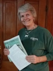 Wisconsin State Farmer subscriber Peg Saenger holds the letter sent to her from Texas after she answered a classified ad in the Trading Post seeking cheese for nuts.
