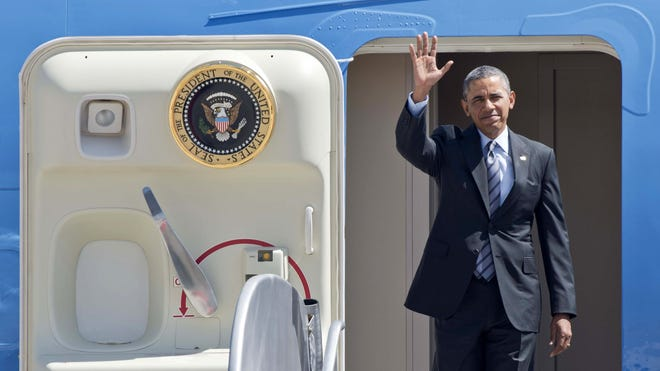 President Obama waves as he disembarks from Air Force One in Toluca, Mexico, on Wednesday.