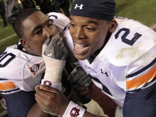 Cam Newton and Nick Fairley celebrate after Auburn