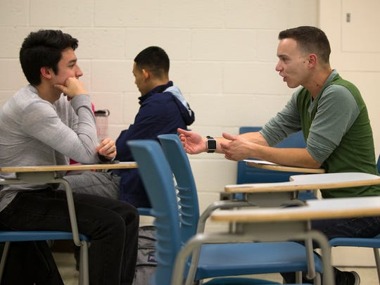Healthcare Theatre Program Coordinator Robert Tilley, right, works with University of Delaware student Michael Wittstein during class at the UD campus.