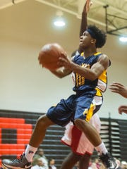 Pocomoke's Tyler Nixon (10) goes for a layup against James M. Bennett last season.