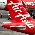 An AirAsia airplane is parked at the airport in Kuala Lumpur on Sunday.